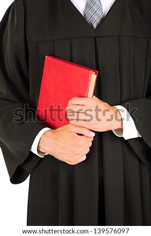 Young graduation man with book, close up