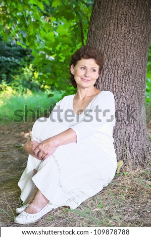 Young grandmother in the park - stock photo