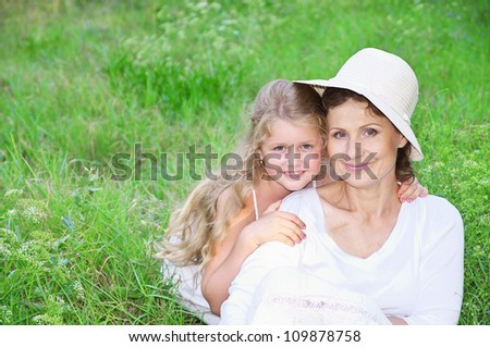 Young grandmother with her granddaughter at the park - stock photo