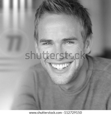 Young great looking male model with nice big real smile - stock photo