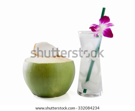 Young green coconut with drinking straw and orchid isolated on white background. - stock photo