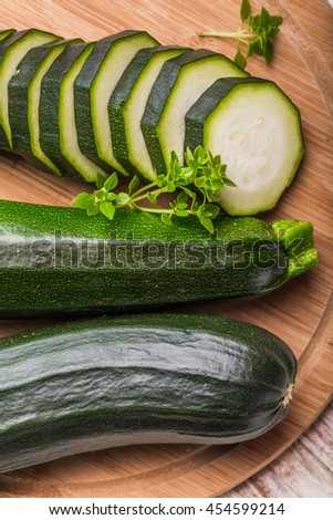 Young green zucchini on the cutting board