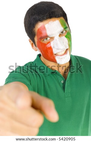 Young, grim Italian sport's fan with painted flag on face. Pointing at something. Front view. Looking at camera, white background - stock photo