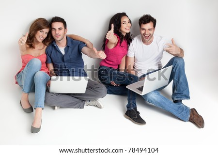 young group happy friends hoding aprooving laptops - stock photo