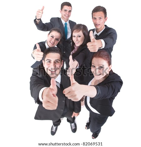 Young group of business people showing thumbs up signs in joy. - stock photo