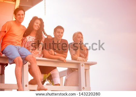Young Group of Friends at the Beach at Sunset in Southern California - stock photo