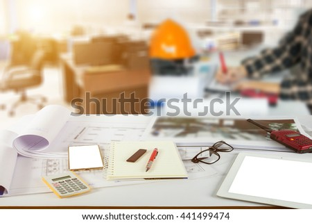Young group of people/architects discussing business plans - stock photo