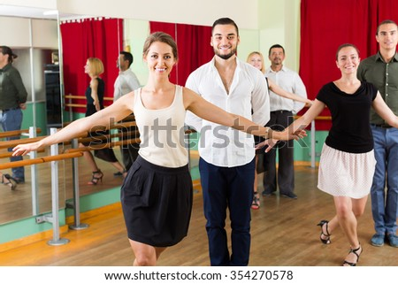 young group of people have fun while dancing waltz - stock photo