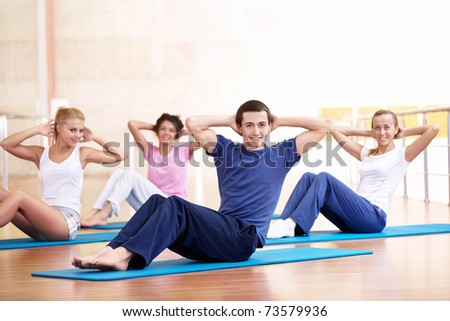 Young group of people involved in fitness - stock photo