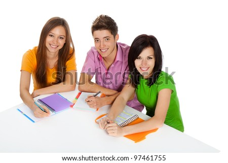 young group of people sitting at the desk, study, learning books, write, read, smile, three students, isolated over white background top angle view - stock photo