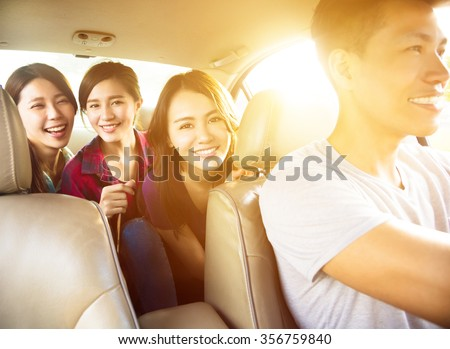 young group people enjoying road trip in the car - stock photo