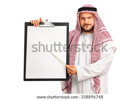 Young grumpy Arab holding a clipboard and pointing on it with a wooden stick isolated on white background - stock photo