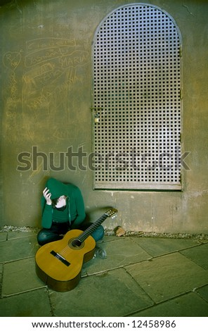 Young guitar performer in urban background. Cross processed. - stock photo