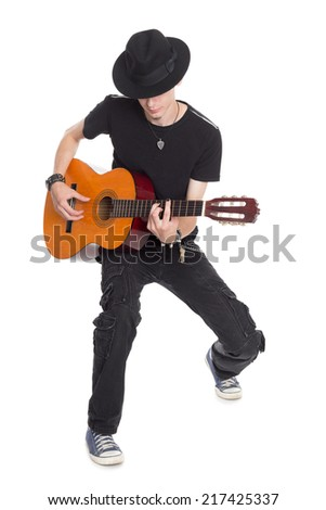 Young guitar player playing his guitar.