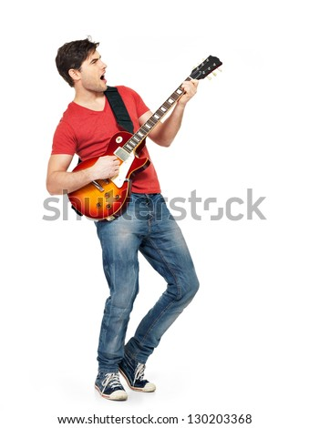 Young guitarist plays on the electric guitar with bright emotions, isolated on white background - stock photo