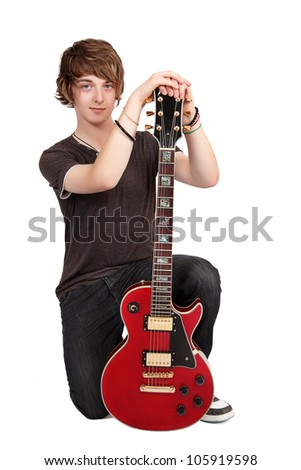 Young guitarist sitting with guitar, isolated on white - stock photo