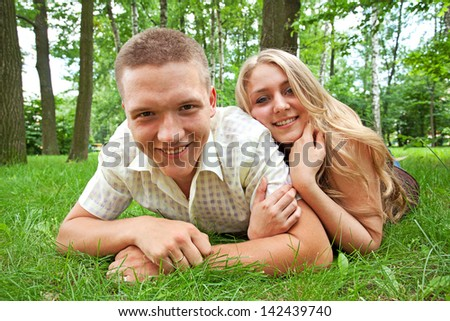 Young guy and girl in city park - stock photo