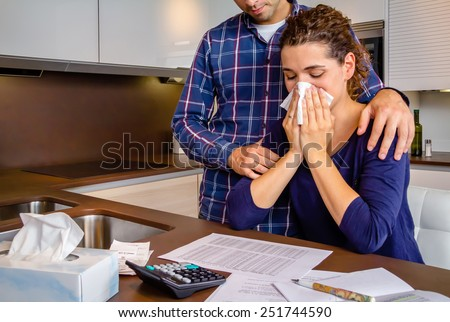 Young guy friend gives solace to desperate unemployed woman crying by her debts. Financial problems concept. - stock photo