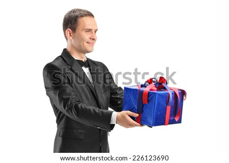 Young guy holding a present - stock photo