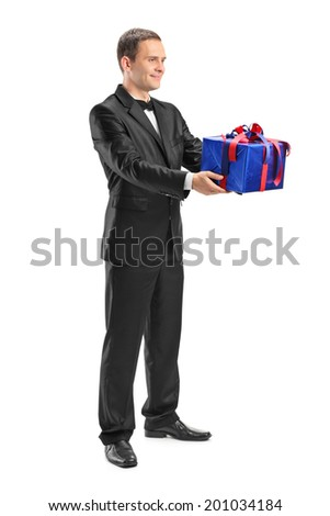 Young guy holding a wrapped present isolated on white background - stock photo