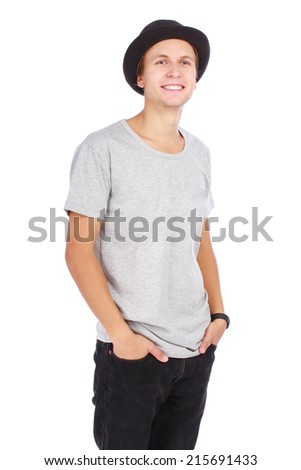 Young guy in a hat and casual t-shirt half length portrait on white background