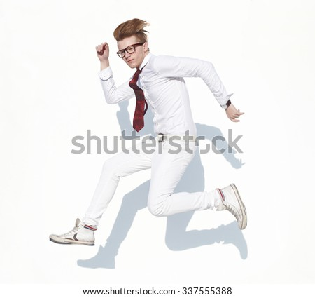 Young guy in white clothes and glasses in hop expression opposite white background - stock photo