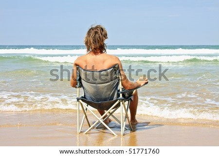 Young guy relaxing at the ocean - stock photo