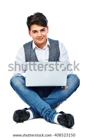 Young guy sitting on the floor crossed legs with notebook. Isolated on white background. - stock photo