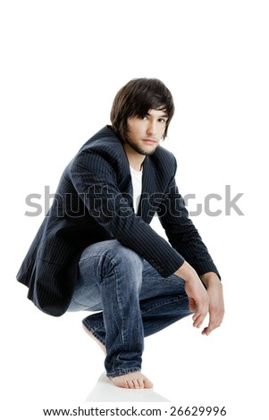 Young guy standing against a white background