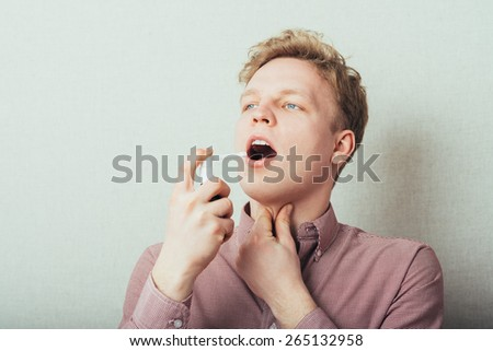 young guy using Inhaler - stock photo