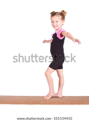 Young gymnast balances on beam isolated on white - stock photo