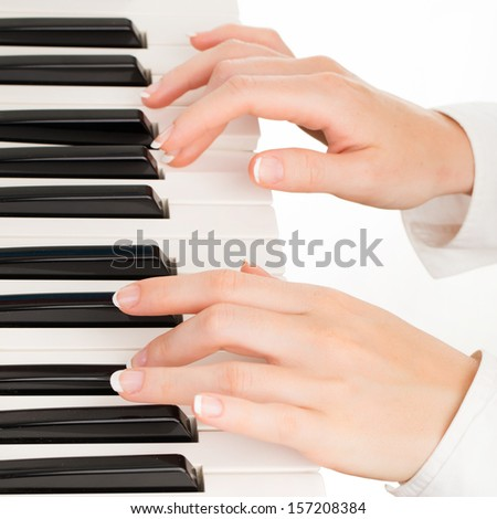 young hands of woman playing synthesizer isolated on white - stock photo