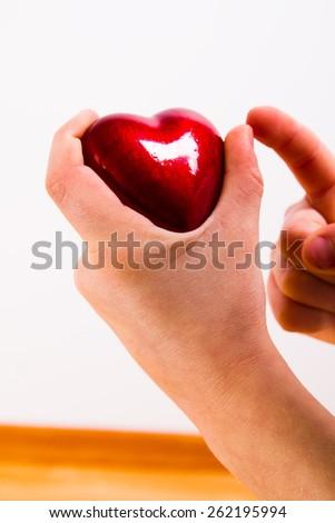 young hands with red heart - stock photo