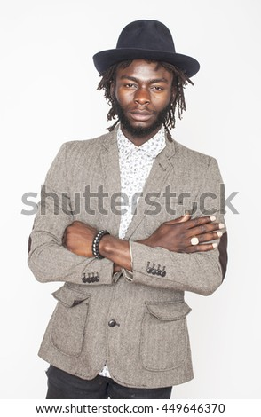 young handsome african american boy in stylish hipster hat gesturing emotional isolated on white background smiling - stock photo