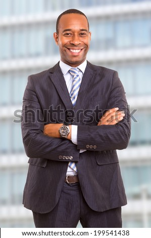 Young handsome african business man posing in front of a modern building - stock photo