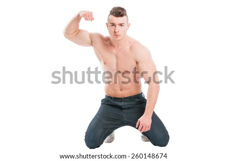 Young, handsome and muscular male model on his knees - stock photo