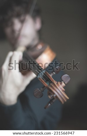 young handsome blonde italian violinist