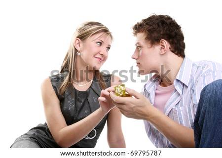 young handsome boy giving a ring gift to his girlfriend - stock photo