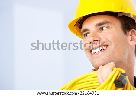 Young handsome builder in yellow uniform. Over white background - stock photo