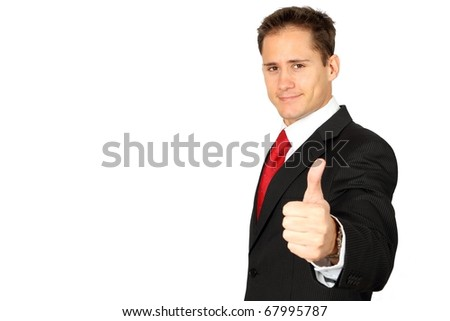 Young handsome business man giving thumbs up - stock photo