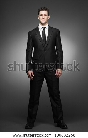 Young handsome business man in white shirt and black suit. - stock photo