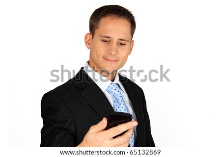 Young handsome business man looking at his smartphone - stock photo