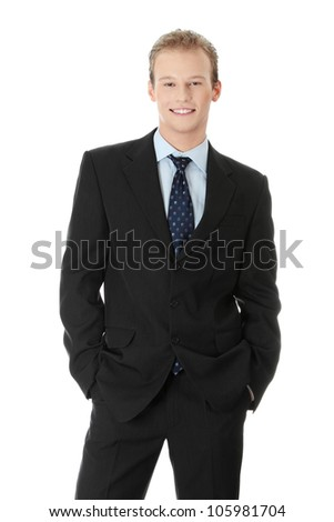 Young, handsome business man wearing black suit, blue shirt and tie smiling. Blond man is satisfied and successful.  Isolated on the white background. - stock photo