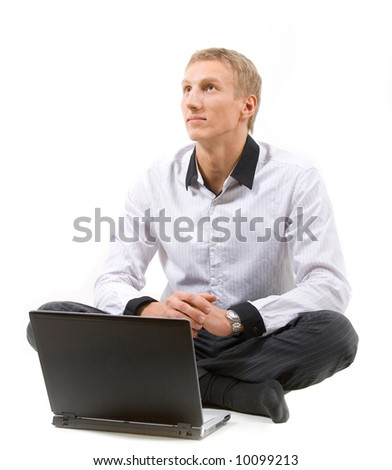 Young handsome business with a modern laptop