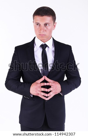 Young handsome businessman isolated on a white background