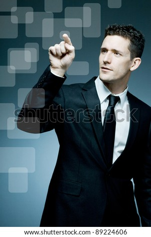Young handsome businessman making pointing gesture.