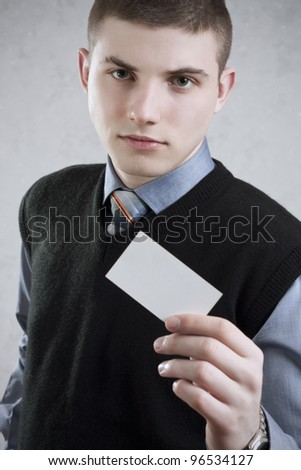 Young handsome businessman offers business card - stock photo