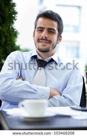 Young handsome businessman on coffee break, outdoor