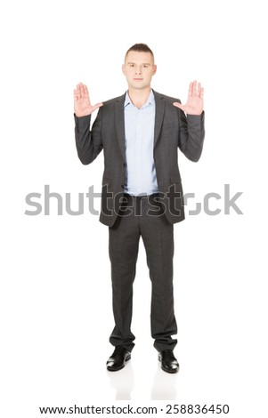 Young handsome businessman pressing abstract screen. - stock photo