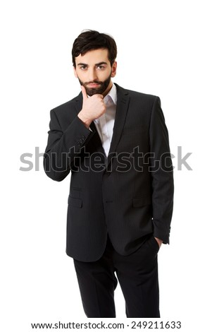Young handsome businessman smiling to camera.